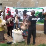 Some of the  send a  seed pig beneficiaries receiving the donated piglets.