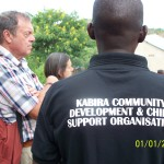 visitors listening carefully to the members of kabira  community